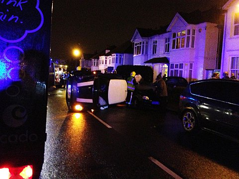 A blue Mini Cooper was left on its side after a collision with a van in Shortlands Road.