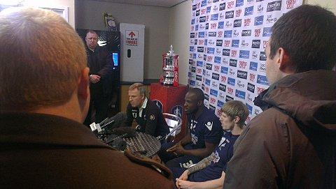 Kenny Jackett, Danny Shittu and Andy Keogh are joined by the FA Cup at Millwall's training ground this morning
