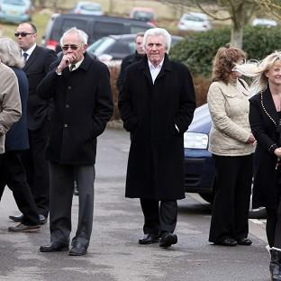 Mourners including Bruce Welch (centre) at the funeral of Reg Presley, singer of The Troggs who scored a global hit with Wild Thing