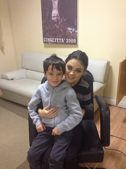 Oliver Crouch, a pupil at Kingswood House School in Epsom, with Hollywood star Mila Kunis