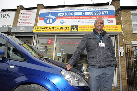 Alieu Bah with his taxi at Broadway Express in Bexleyheath.