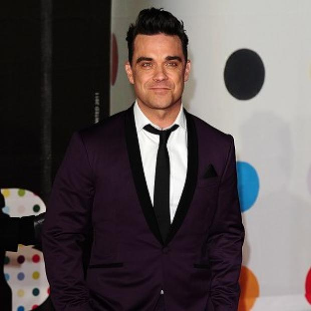 Robbie Williams wants to add to his brood