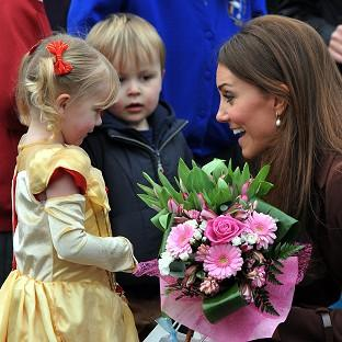The Duchess of Cambridge meets Isobelle Laursen and Oliver Axcell, both three, on a visit to the Peak Lane Fire Headquarters in Grimsby