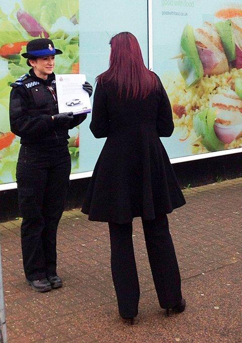 A policewoman speaks to a lady outside the Co-Op in bid to find witnesses.