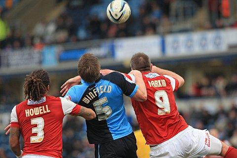 Dave Winfield shows his battling qualities in a tangle with Fleetwood's Jon Parkin
