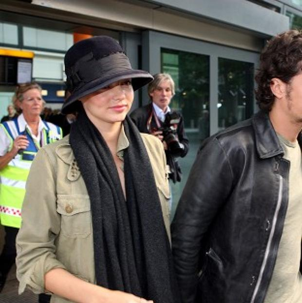 Orlando Bloom has been taking care of model wife Miranda Kerr after her car crash