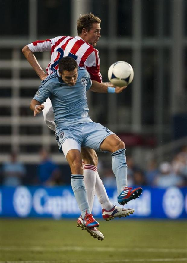 Neven Markovic tangles with Stoke City's Peter Crouch in a  friendly last summer. Picture: Action Images