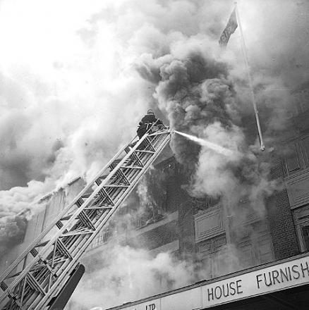 Firefighters tackling the blaze at Harrison Gibson furniture store, Bromley, in 1968