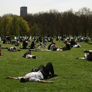 This Is Local London: People enjoy the warm weather in Green Park, central London (PA)