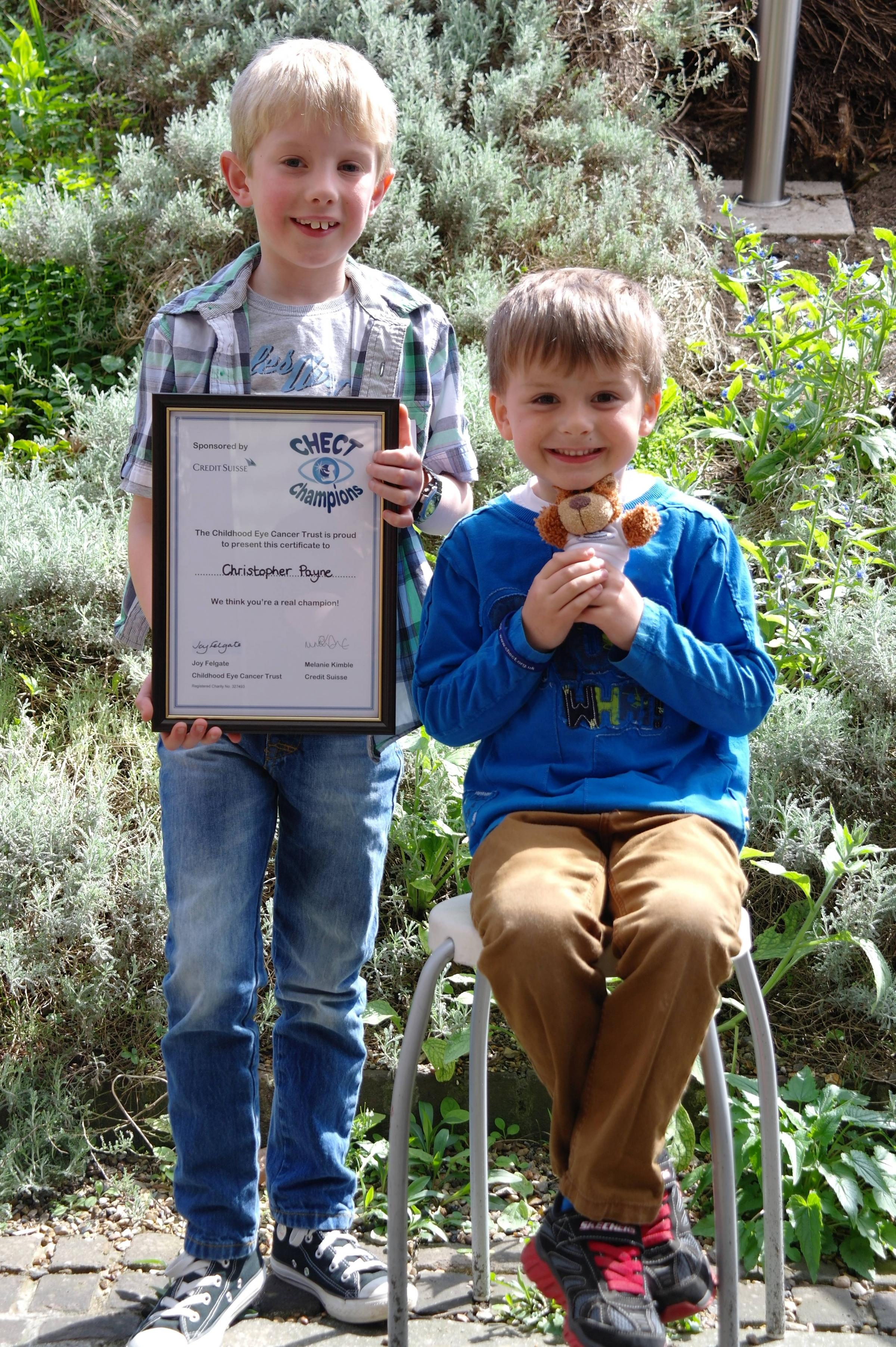 Boy with rare eye cancer and brother commended for bravery
