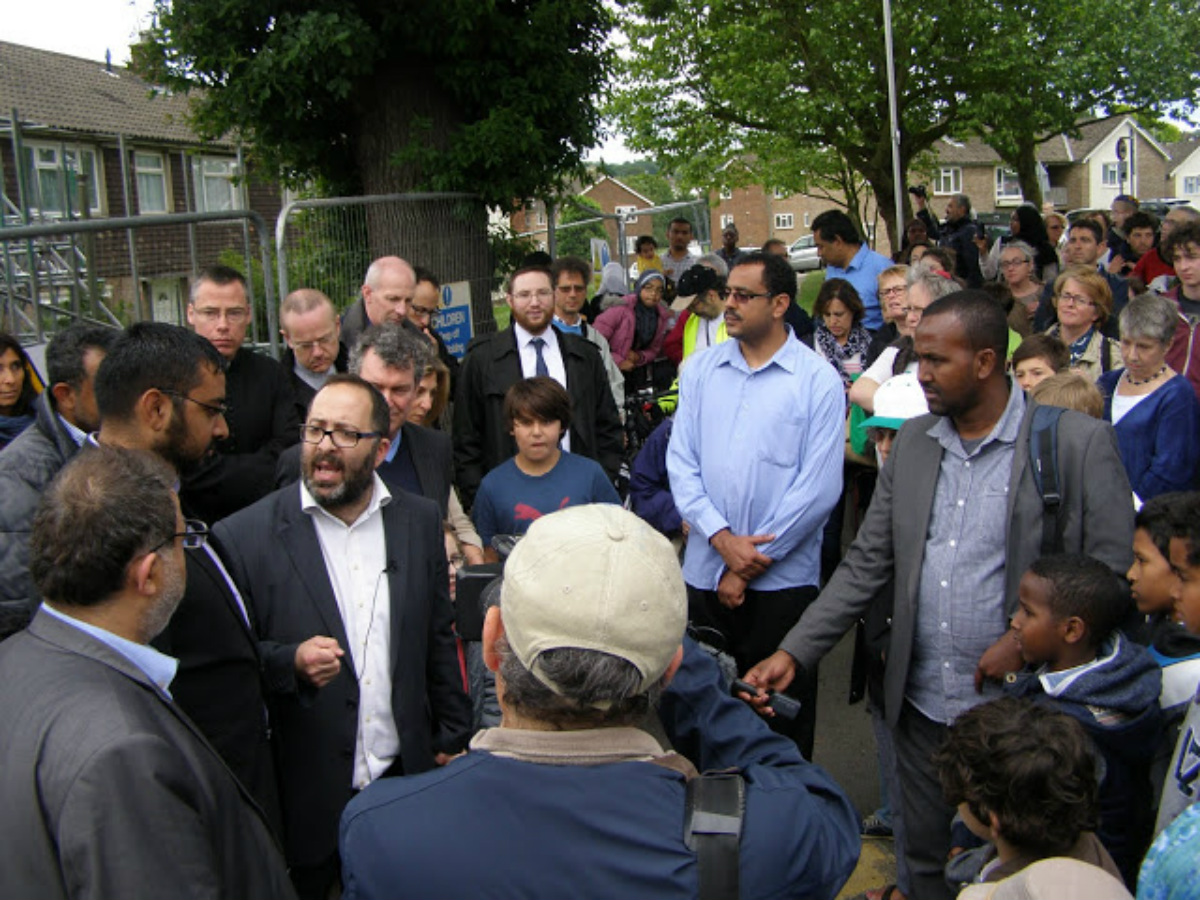 Hundreds of people from all different faiths attended a vigil after the blaze