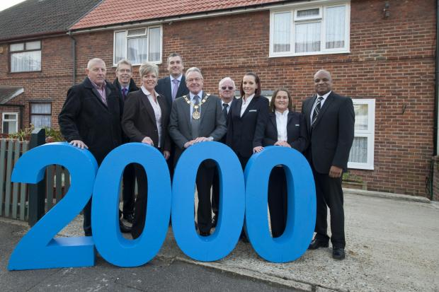 Sutton Housing Partnership staff are joined by the mayor to mark the 2,000th window they have installed