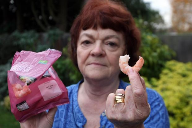 Tina Thompson, 69, from Stoneleigh, holds the packet of prawns