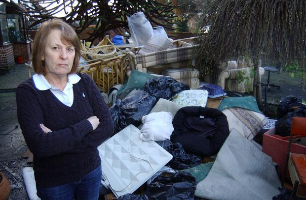 This Is Local London: Rosemary Clay has been forced to throw out her furniture which was ruined in the floods