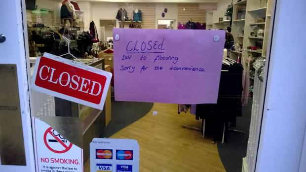 The Queen Elizabeth Foundation charity shop in Epsom High Street was flooded