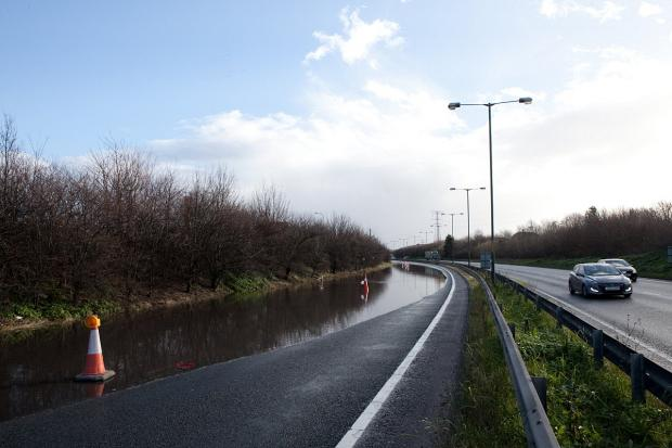 This Is Local London: PICTURED: Flooding causes closure of A206 Bob Dunn Way in Dartford