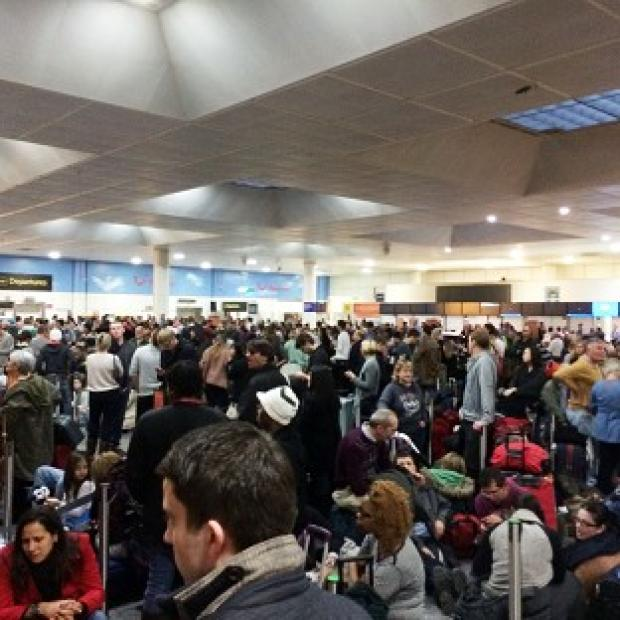 This Is Local London: Passengers waiting at the North Terminal at Gatwick as flights were cancelled due to bad weather (Daniel Cawthorne).