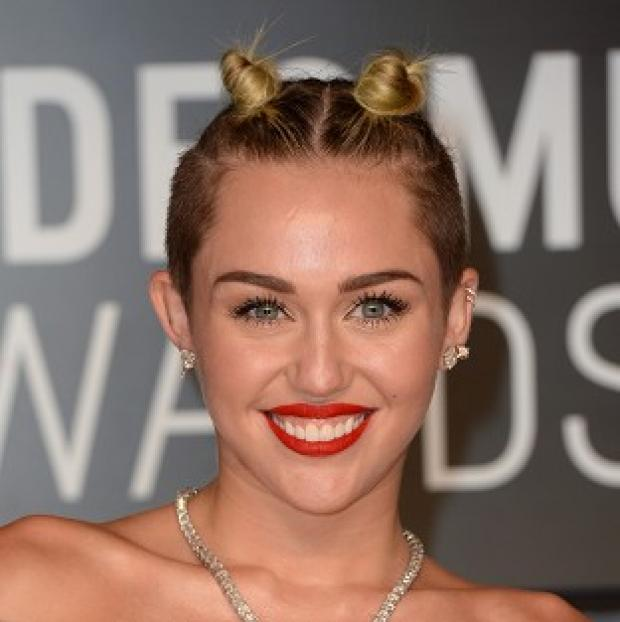 This Is Local London: Miley Cyrus's video for Wrecking Ball should only be shown after 10pm, a French body said