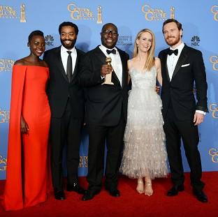 This Is Local London: From left, Lupita Nyong'o, Chiwetel Ejiofor, Steve McQueen, Sarah Paulson and Michael Fassbender with the award for best motion picture - drama (AP)