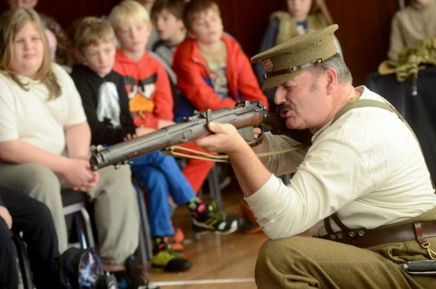 Craig Appleton shows a rifle at Bourne Hall Museum Kids Club