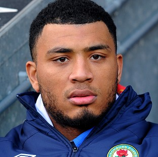 Blackburn Rovers footballer Colin Kazim-Richards is accused of making a homophobic gesture during a match