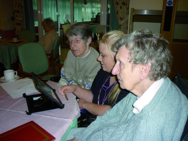 Residents at Greenacres in the Horseshoe, Banstead, learn how to use an iPad