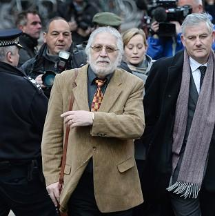 This Is Local London: DJ Dave Lee Travis, centre, arrives at Southwark Crown Court in London