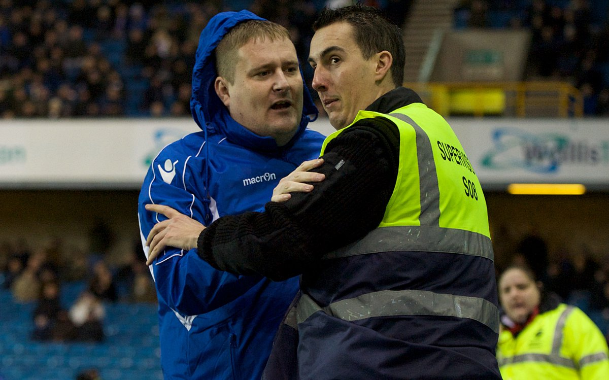 Ian Wilson with a steward at The Den (pic by Focus Images)