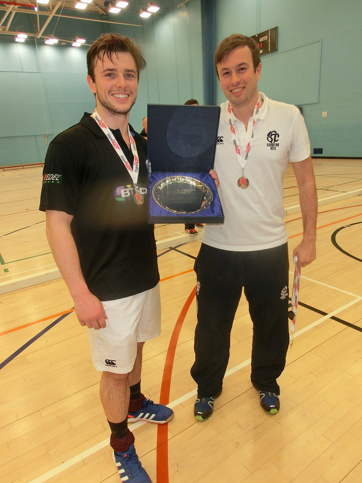 All smiles: Guest star Rufus McNaught-Barrington, left, with the Division One crown and manager James Lloyd 	Sean Cotter