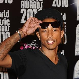 Pharrell Williams has remained in pole position with his feel-good hit Happy