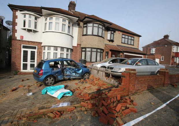 The blue Clio smashed through a front wall, throwing bricks through windows