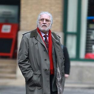 This Is Local London: DJ Dave Lee Travis arrives at Southwark Crown Court in London where he is accused of a series of indecent assaults and one sexual assault.