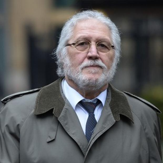 This Is Local London: Former DJ Dave Lee Travis arrives at Southwark Crown Court in London, where he is accused of a series of indecent assaults and one sexual assault