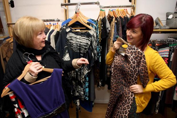 Help needed: Pam Ling helping with the charity shop selection