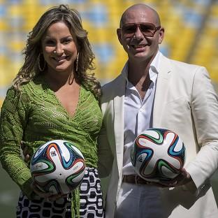 Brazilian singer Claudia Leitte and rapper Pitbull will perform with Jennifer Lopez the official song for the 2014 World Cup (AP Photo/Felipe Dana)
