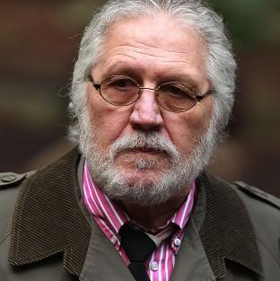 DJ Dave Lee Travis arrives at Southwark Crown Court in London, where he is accused of a series of indecent assaults and one sexual assault