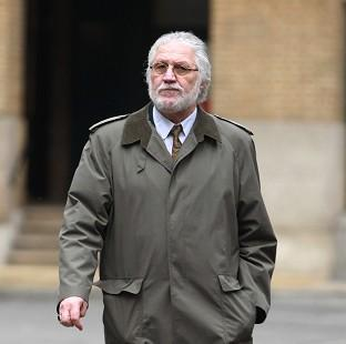 This Is Local London: Former DJ Dave Lee Travis arrives at London's Southwark Crown Court, where he is accused of a series of indecent assaults and one sexual assault