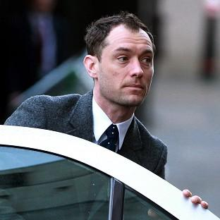 Jude Law arrives at the Old Bailey in London to t