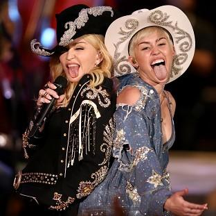 "This Is Local London: Miley Cyrus performs with Madonna for MTV Tuesday Jan. 28, 2014. The 21-year-old pop star and the 55-year-old Queen of Pop grinded and grabbed each other as they performed Cyrus' hit ""We Can't Stop"" and Madonna's 2000 track ""Don't Tell Me""  Tuesday during"