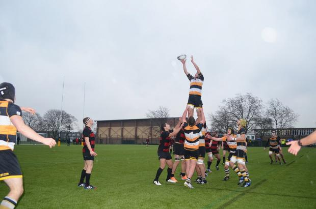 This Is Local London: Flying high: Hampton School's lineout worked to perfection in wet conditions on Wednesday