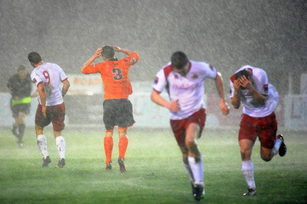This Is Local London: Run for it: Whitstable Town players run for cover during the storm that forced the abandonment of Saturday's game
