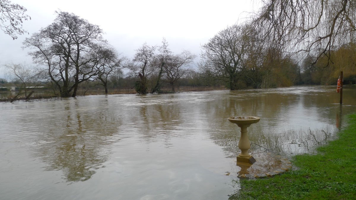 River Mole bursts its banks a cemetery in Leatherhead yesterday