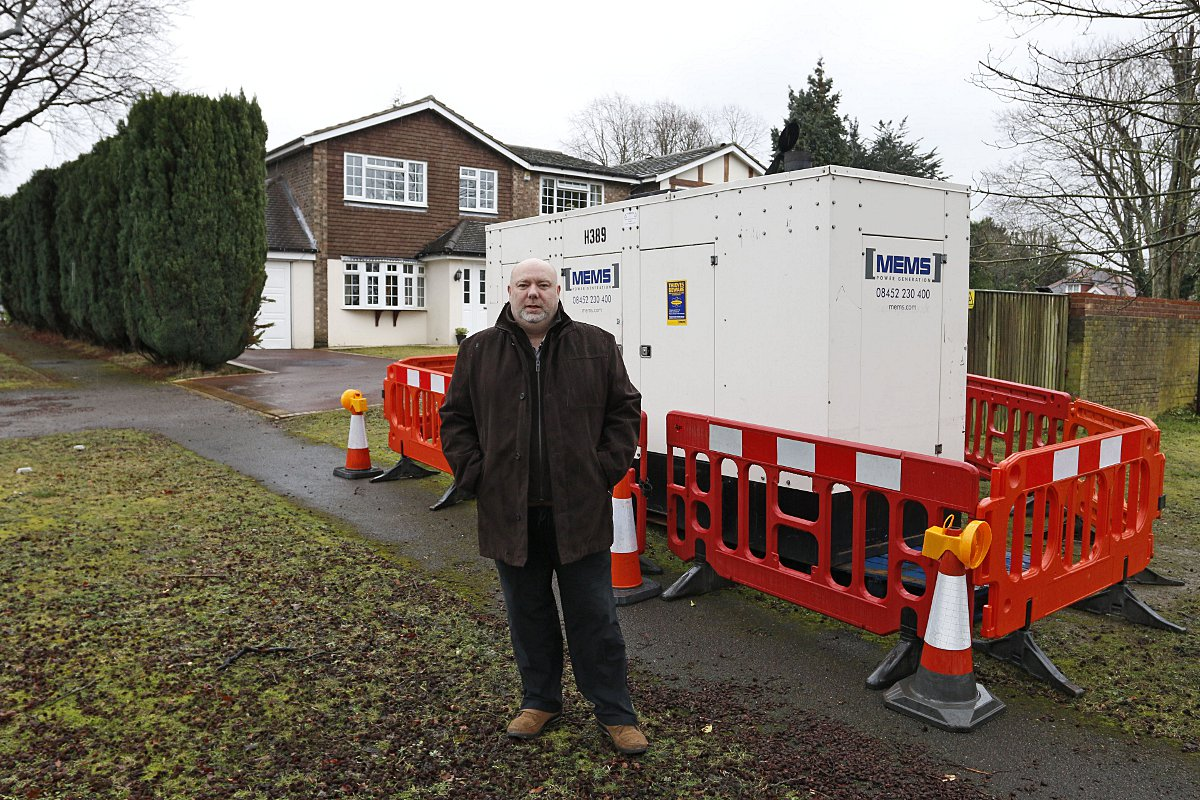 Brian Warner outside his house, with the generator, in High Beeches, Banstead