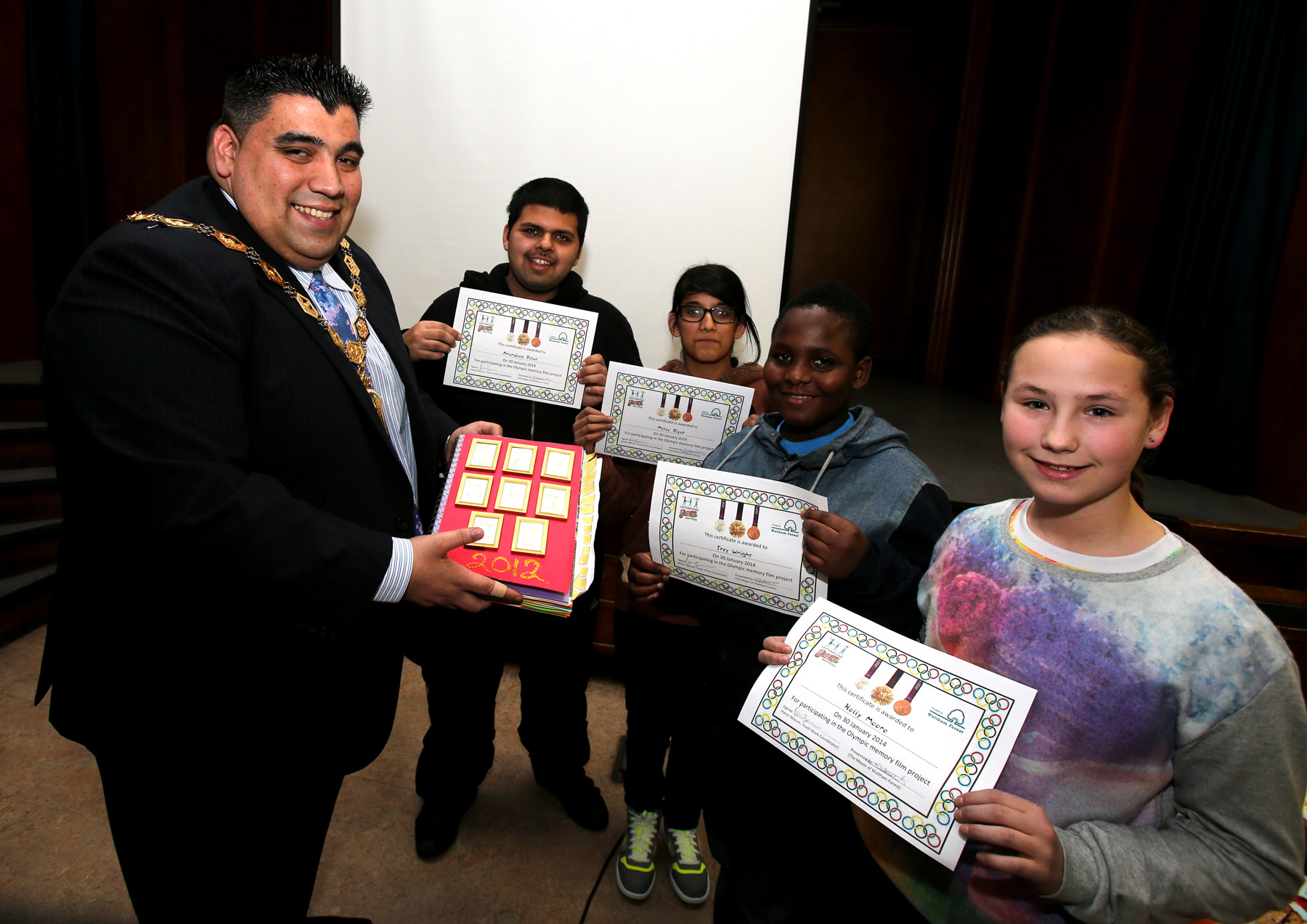 Waltham Forest Mayor Nadeem Ali with Leytonstone Youth Matters members Tray Wright, Amardeep Riyat, Mitsy Riyat, Holly Moore and their scrapbook.