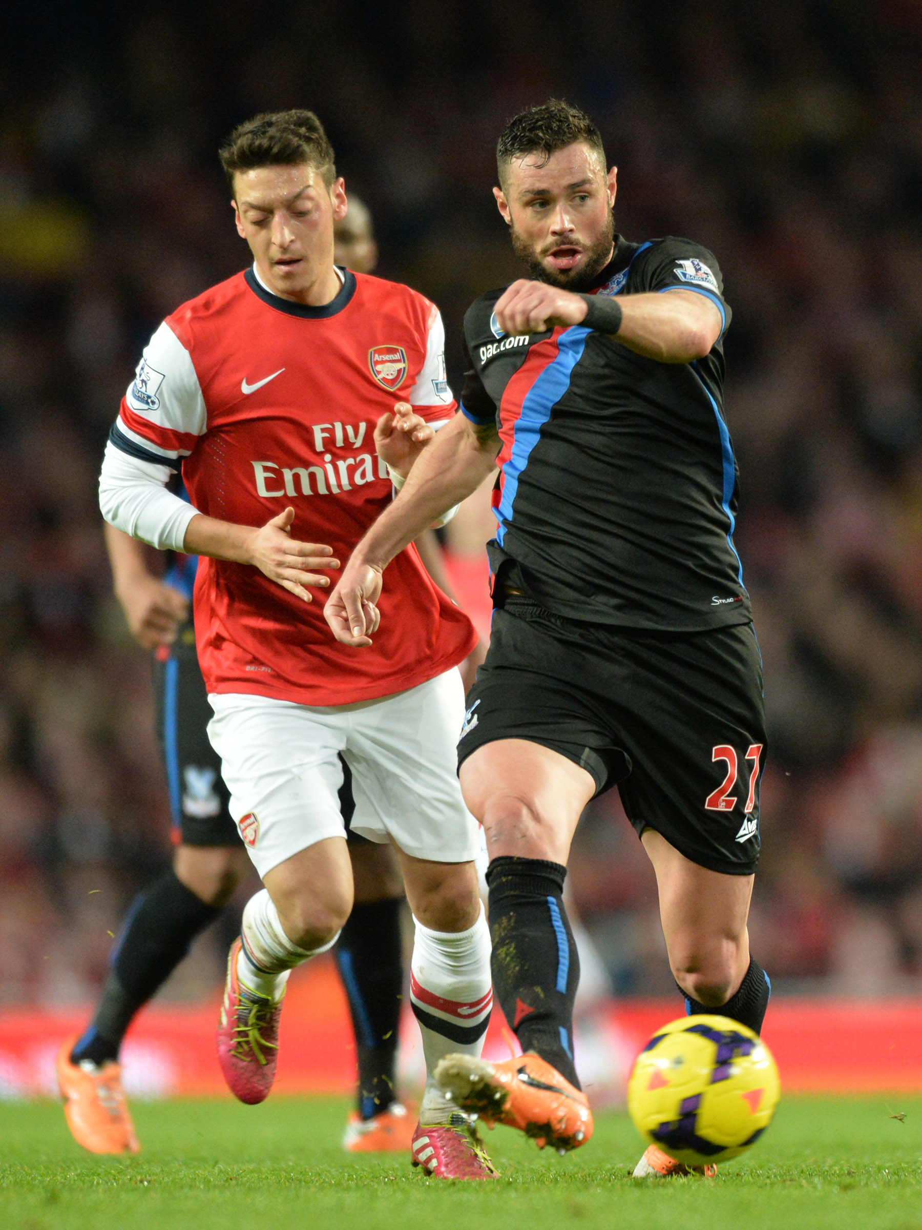 This Is Local London: The Eagles defender gets the better of German star Mesut Ozil at the Emirates. PICTURE BY KEITH GILLARD.