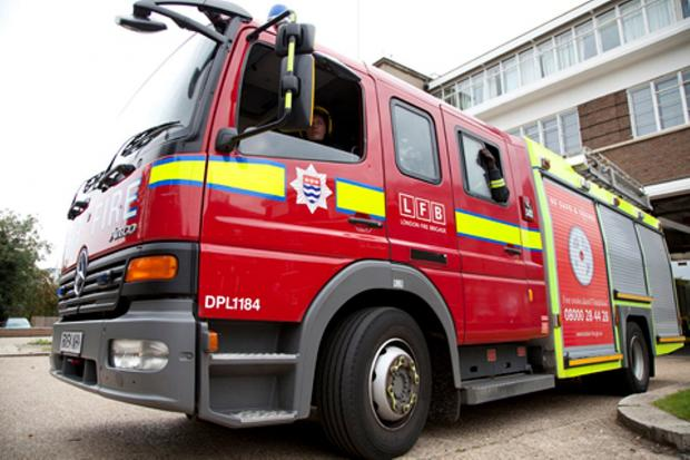 Woman rescued from Thamesmead house fire