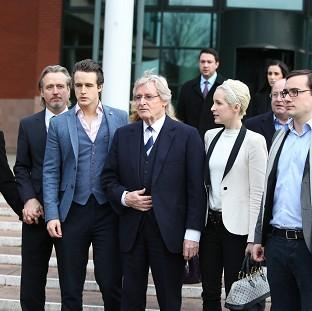 Coronation Street actor William Roache and his family outside court