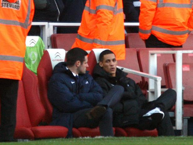 This Is Local London: Tom Ince and fellow new Eagle Scott Dann watch Sunday's 2-0 defeat at Arsenal from the bench