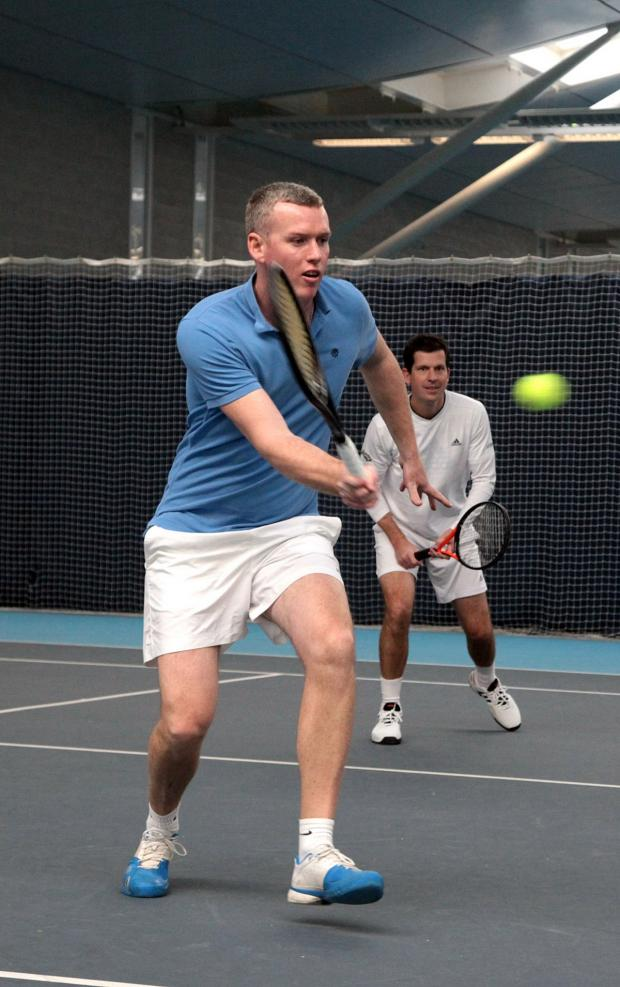 This Is Local London: Long haul: Richmond Tennis Club coach Michael Jones joined Tim Henman, right, on court at the National Tennis Centre in Roehampton to raise money for charity 	SP82668