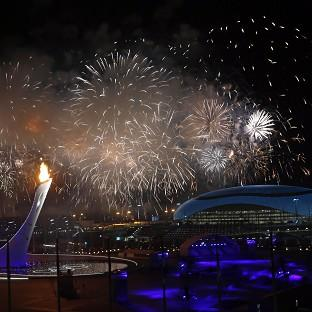 This Is Local London: Fireworks are seen over the Olympic Park during the opening ceremony of the 2014 Winter Olympics in Sochi (AP)